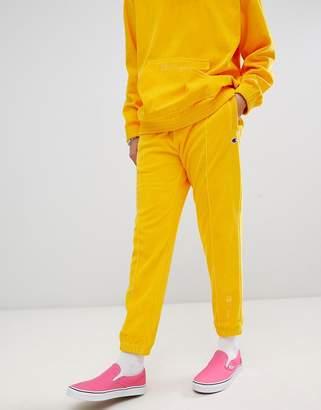 Champion velour sweatpants in yellow