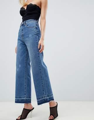 PrettyLittleThing wide leg raw hem jeans in blue