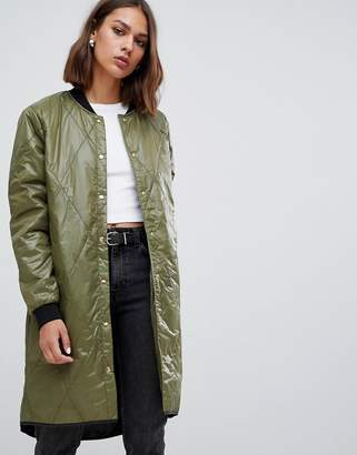 Minimum quilted longline bomber