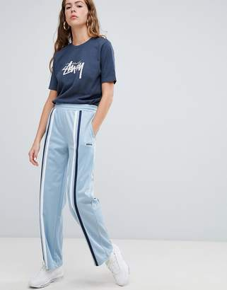 Stussy Wide Leg Track Pants With Front Stripes