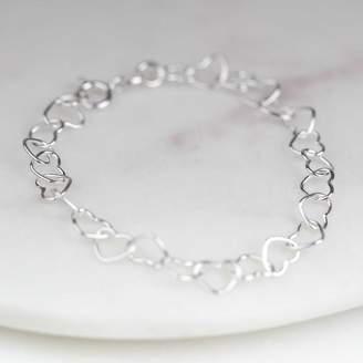 Nest Child's Bracelet With Interlocking Silver Hearts