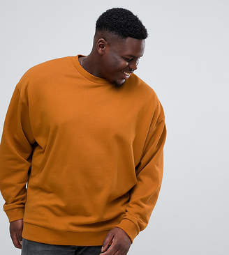 Asos DESIGN plus oversized sweatshirt in rust