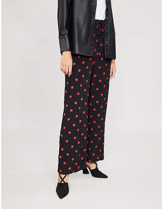 Ganni Barra polka-dot high-rise wide crepe trousers