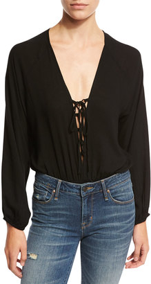 Lucca Couture Long-Sleeve Lace-Up Bodysuit, Black $59 thestylecure.com