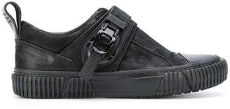 Both buckled low-top sneakers