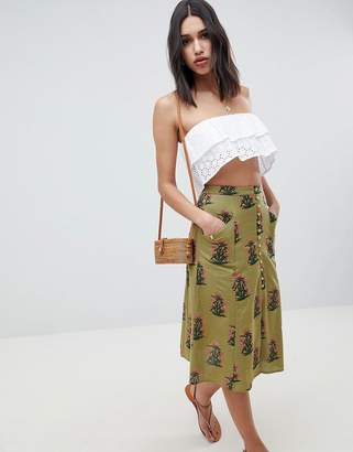 Asos Design DESIGN button front a-line midi skirt in green floral print