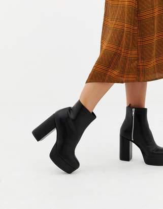 Monki zip heeled platform boot in black