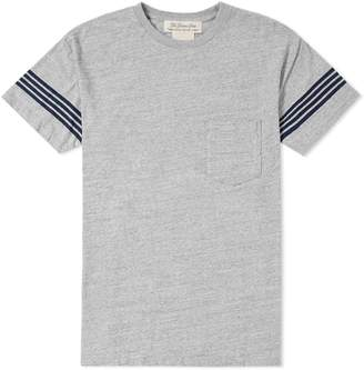 Remi Relief Four Stripe Sleeve Pocket Tee