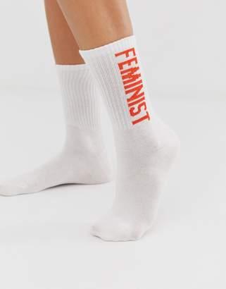 Monki sport socks with Feminist slogan in white