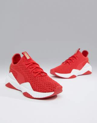 Puma Training Defy Knitted Sneakers In Red And Gold