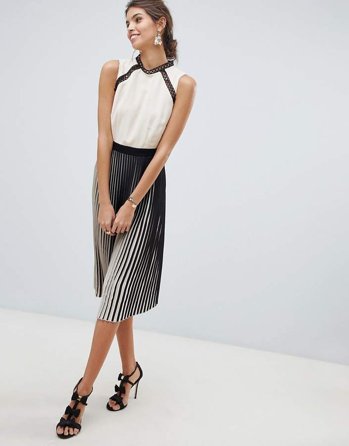 two tone pleated skirt and crochet inserts mock neck midi dress
