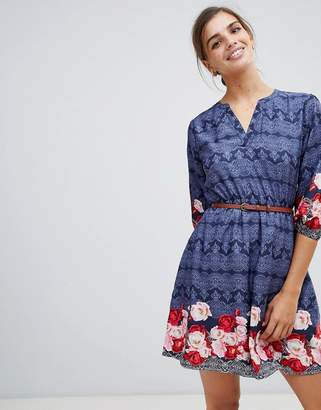 Yumi belted dress with 3/4 sleeves in rose border print