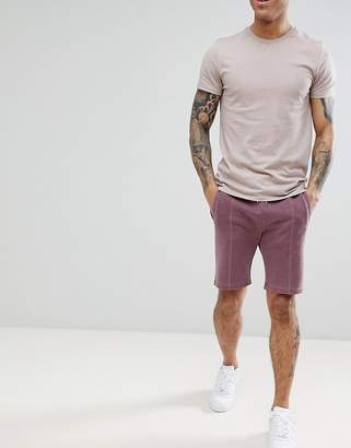 Asos DESIGN skinny shorts in overdyed purple pique