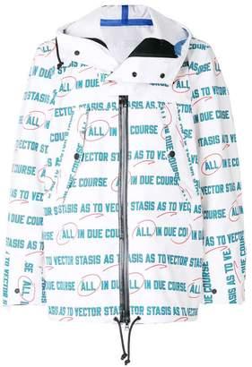 Sacai Vector print raincoat