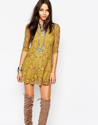 Free People Walking To The Sun Dress With Lace Overlay $168 thestylecure.com