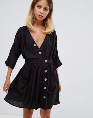 Asos DESIGN casual mini dress with pocket & side buttons