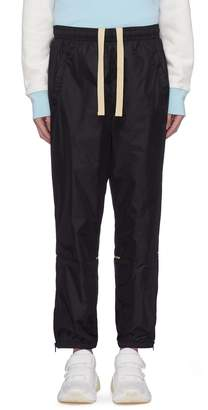 Acne Studios Contrast piping zip cuff track pants