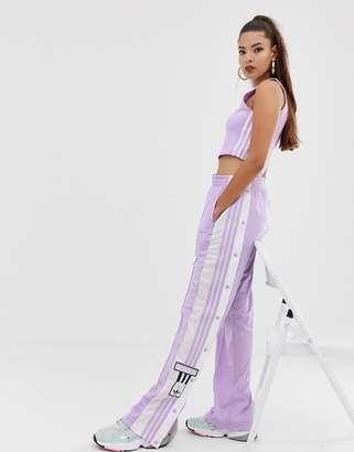 173e334adc9d adidas adicolor Adibreak popper pants in purple