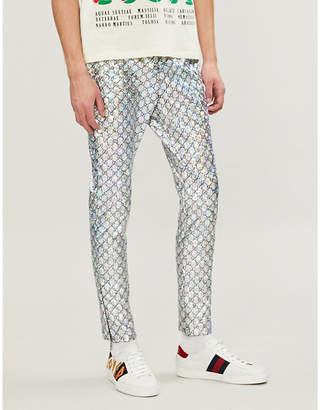 Gucci Metallic logo-print slim-fit tapered shell trousers