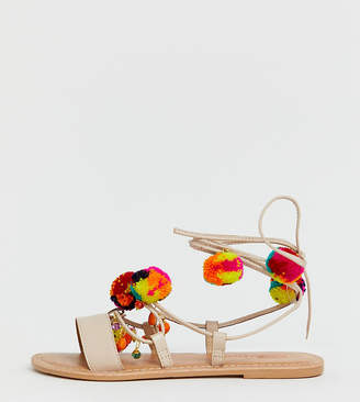 cc686c04a3a0 Asos Design DESIGN Wide Fit Fun Fair pom pom leather tie leg flat sandals