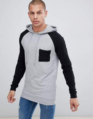 Asos DESIGN muscle longline hoodie with contrast raglan sleeves and chest pocket