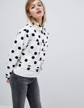 Asos DESIGN denim jacket in polka dot print