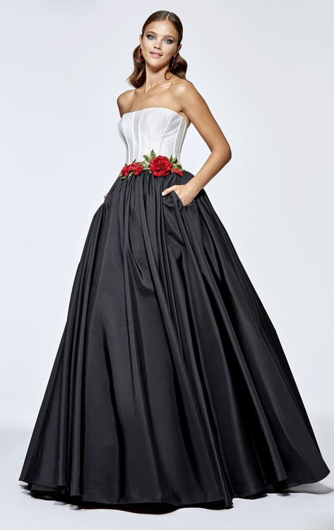 Draw out the princess in you with this evening dress by Tarik Ediz 93112. This long gown features a strapless and straight neckline. Corset boned bodice makes a feminine silhouette. Floral embellishments highlight the waist. Contrasting full ball skirts with side pockets complete the look. A sure winner from Tarik Ediz creation!