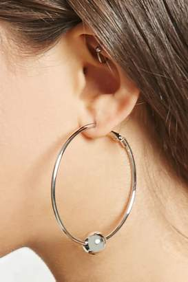 FOREVER 21+ Ball Hoop Earrings $5.90 thestylecure.com