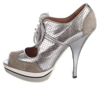 Alaia Platform Caged Sandals