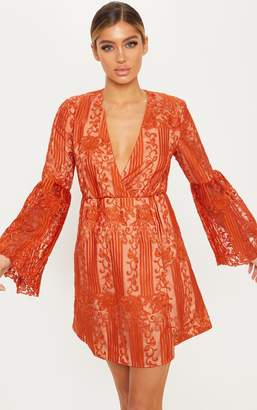 PrettyLittleThing Rust Lace Flared Sleeve Wrap Skater Dress
