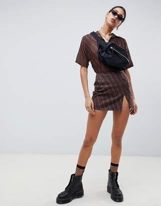 Motel mini skirt with front split in geometric print