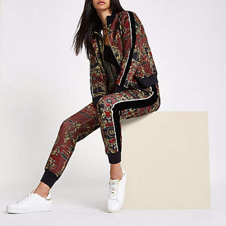 River Island RI 30 red scarf print tracksuit bottoms