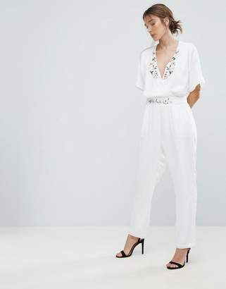 Yumi Jumpsuit With Floral Trim