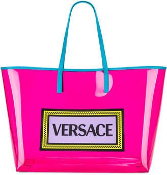 Versace Clear Vinyl Logo Tote in Pink   FWRD