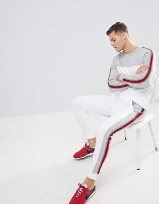 Asos DESIGN tracksuit sweatshirt/skinny joggers with color blocking and side stripes
