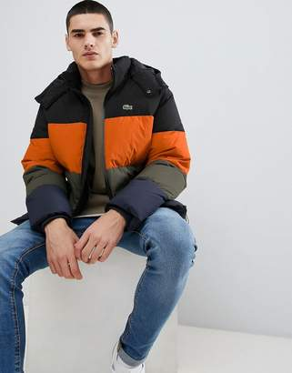 Lacoste padded hooded color block puffer jacket in black