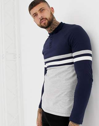 Asos Design DESIGN long sleeve polo shirt with contrast body and sleeve  panels in navy  94c9421ac741