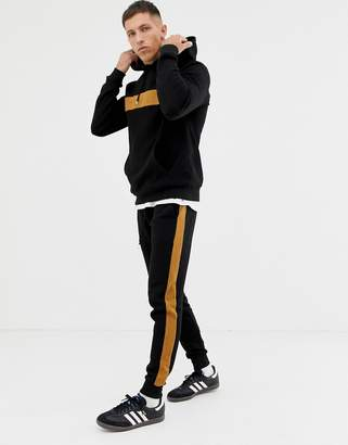 Asos DESIGN tracksuit hoodie/ skinny sweatpants with color blocking and side stripe