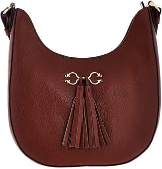 C. Wonder Pebble Leather Hobo Handbag with Hardware & Tassel Detail