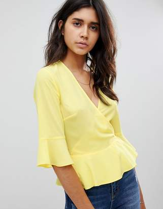 Warehouse wrap front blouse with flute sleeve in yellow