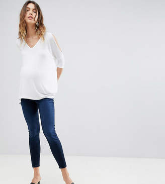 Asos DESIGN Maternity Ridley high waisted skinny jeans in blue black wash with under the bump waistband