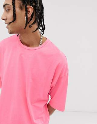 Asos Design DESIGN oversized t-shirt with half sleeve in washed neon pink