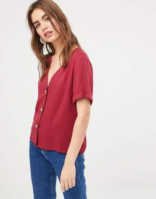 Asos DESIGN boxy top with contrast buttons