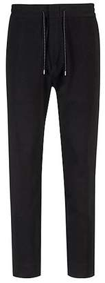 HUGO BOSS Tapered-fit trousers in technical stretch fabric