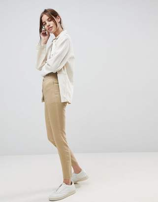 Asos DESIGN ankle length stretch skinny pants in stone with zip side pockets