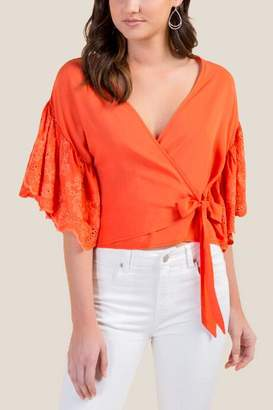 db4e273c5d3fe francesca s Candice Eyelet Sleeve Wrap Top - Orange