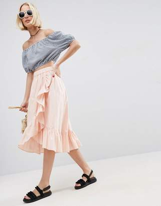 ASOS Wrap Midi Skirt in Cotton with Ruffle Hem $40 thestylecure.com
