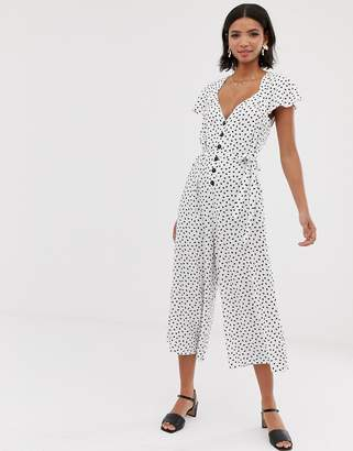 c45c73178f6 Asos Design DESIGN flutter sleeve spot print jumpsuit with button front