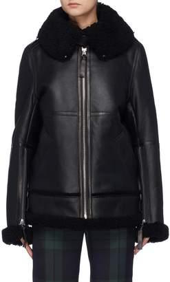 Acne Studios Zip cuff throatlatch oversized shearling coat