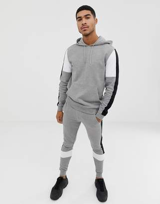Asos Design DESIGN tracksuit hoodie/super skinny sweatpants with color blocking and side stripe in gray marl